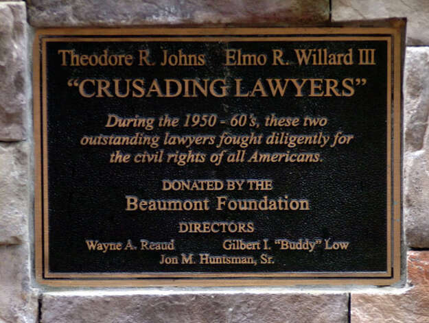 The plaque on display with the statues of Theodore Johns, Sr. and Elmo Willard near the public entrance to the Jefferson County Courthouse. Pete Churton/The Enterprise