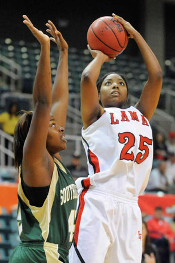 Lamar forward Trashanna Smith, right, puts up a jump shot over Southeastern Louisiana's Zevy Ivory during the first half of their game  in the Southland Conference Tournament at the Merrell Center in Katy.  Tuesday, March 9, 2010.  Valentino Mauricio/The Enterprise