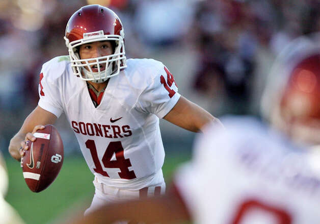1. St. Louis Rams - QB Sam Bradford - Oklahoma quarterback Sam Bradford (14) looks to pass against Texas A&M during the second quarter of an NCAA football gam in College Station, Texas. (AP Photo/David J. Phillip) / AP2008