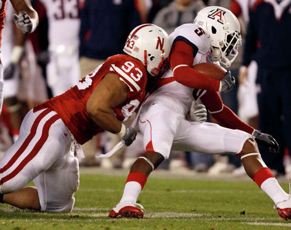 2. Detroit Lions - DT Ndamukong Suh - Nebraska defensive tackle Ndamukong Suh drags down Arizona quarterback Matt Scott during the fourth quarter of the Holiday Bowl NCAA college football game won by Nebraska 33-0 Wednesday, Dec. 30, 2009, in San Diego. (AP Photo/Denis Poroy) / FR59680 AP