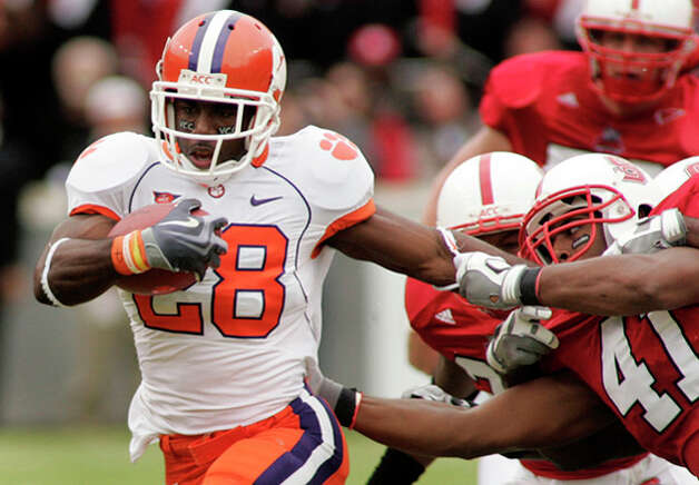 9. Buffalo Bills - RB C.J. Spiller - Clemson's running back C.J. Spiller (28) fights off the tackle attempt of North Carolina State's linebacker Dwayne Maddox (41) during the second half of an NCAA college football game in Raleigh, N.C. (AP Photo/Jim R. Bounds) / FR3003 AP