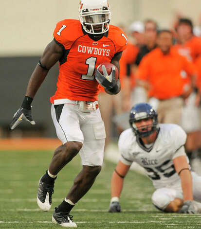 24. Dallas Cowboys - WR Dez Bryant - Rice safety Travis Bradshaw, right, watches as Oklahoma State wide receiver Dez Bryant, runs down field during the first half of an NCAA college football game in Stillwater, Okla. (AP Photo/Brody Schmidt) / FR79308 AP