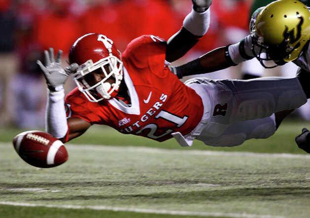 27. New England Patriots - CB Devin McCourty - Rutgers' Devin McCourty (21) dives for a South Florida fumble during the first quarter of an NCAA  college football game in Piscataway, N.J. (AP Photo/Mel Evans) / AP2009