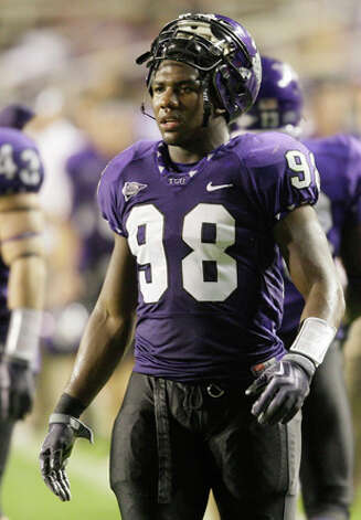 31. Indianapolis Colts - DE Jerry Hughes - TCU defensive end Jerry Hughes watches from the sidelines during the final minutes of an NCAA college football game against Texas State in Fort Worth, Texas. (AP Photo/Donna McWilliam) / AP