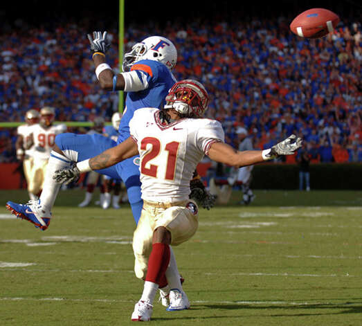 32. New Orleans Saints - CB Craig Robinson - Florida State cornerback Patrick Robinson, right, breaks up a long pass intended for Florida's Chris Rainey during the first half of an NCAA college football game in Gainesville, Fla. (AP Photo/Phelan M. Ebenhack) / AP2009