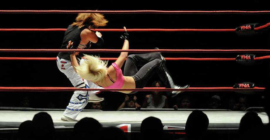 Two women wrestle in the ring. Guiseppe Barranco/The Enterprise