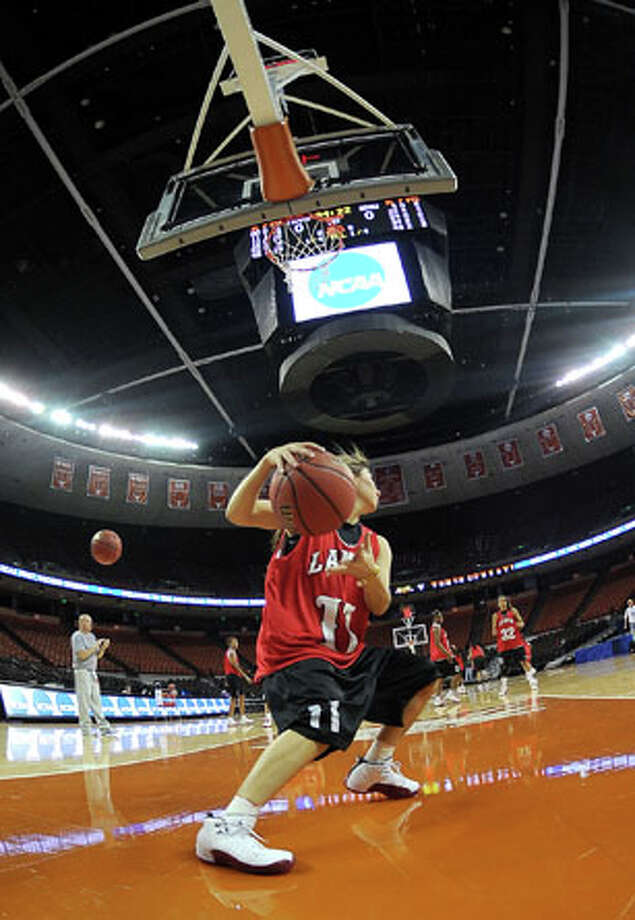 Lamar's Jena Plumley works drills during practice at the Frank Erwin Center on Saturday. The Lady Cards will go head to head with West Virginia Sunday night in the NCAA Tournament. Guiseppe Barranco/The Enterprise