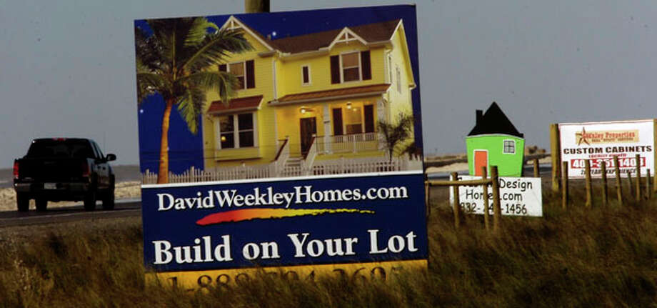 As you leave High Island and head for Gilchrist and Crystal Beach, the side of the highway has all kinds of signs for building your new beach house.     Dave Ryan/The Enterprise