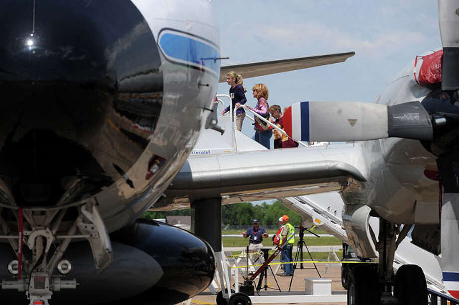 Guests climb aboard a P-3 hurricane research plane Monday to learn how hurricane scientists study storms from the air. Guiseppe Barranco/The Enterprise