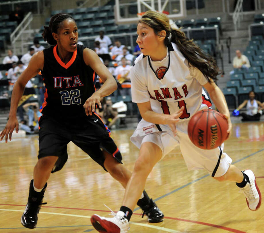 Lamar's Jenna Plumley drives around UTA's Nicole Terral during the Southland Conference Tournament play-offs at the Merrell Center in Katy, Thursday.  Tammy McKinley/ The Enterprise