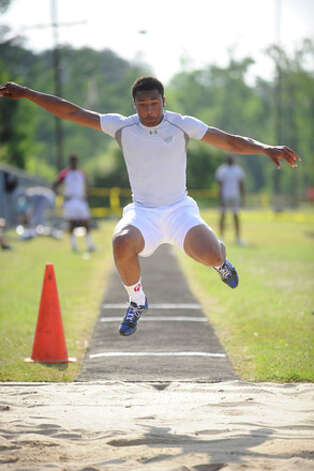West Orange-Stark's Trey Franks competes in the long jump during the  District 21-3A Track and Field Championships at Silsbee High School.    Valentino Mauricio/The Enterprise
