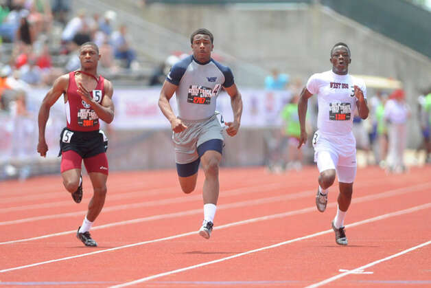 West Orange-Stark's Trey Franks, center, explodes through the finish line in the boys 3A 100 meter dash with a winning time of 10.62 at the UIL State Track and Field Championships in Austin on Saturday. May 15, 2010. Valentino Mauricio/The Enterprise