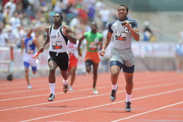 West Orange-Starks's Trey Franks, right,  blasts through the finish line in the final leg of the boys 3A 4x200 relay with a winning time of 1:26.74 at the UIL State Track and Field Championships in Austin on Saturday. May 15, 2010. Valentino Mauricio/The Enterprise