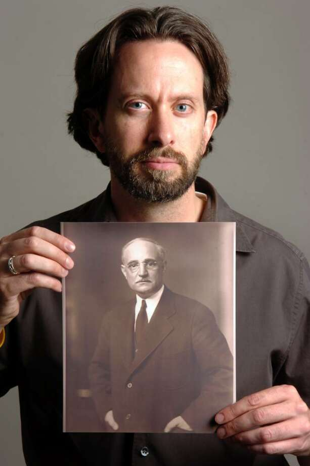 Author Robert Kalm, of Bridgeport, holds a portrait of Philip Musica (1877-1938), in Bridgeport, Conn. on Sept. 10th, 2009. Kalm is writing a book, American Swindle, documenting the life of Musica, who lived a life of bootlegging and finacial fraud through the 1920s and 1930s. Photo: Ned Gerard / Connecticut Post