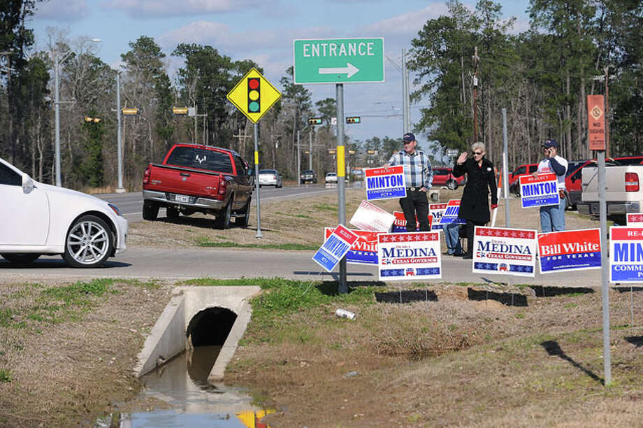 From left, Henry Norris, Johnnie Andres and Darell Minton greet parents and voters at Oak Forrest Elementary in Vidor. Guiseppe Barranco/The Enterprise / Beaumont