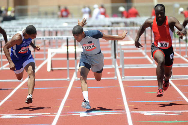 West Orange-Stark's Phillip Jones, center, clears the last hurdle on his way to a first place finish in the 110 meter hurdles during the Class 3A Region III Track & Field Championships at Turner stadium in Humble. Tuesday May 4, 2010.  Valentino Mauricio/The Enterprise