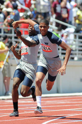 West Orange-Stark's Phillip Jones, right, takes the baton handoff from teammate Justin Thomas, left, in the 4x200  meter relay, setting a meet record with a time of 1.26:12 during the Class 3A Region III Track & Field Championships at Turner stadium in Humble. Tuesday May 4, 2010.  Valentino Mauricio/The Enterprise