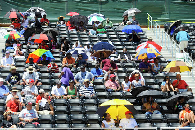 Track and field fans came prepared for the 90 degree heat during the Class 3A Region III Track & Field Championships at Turner stadium in Humble. Tuesday May 4, 2010.  Valentino Mauricio/The Enterprise