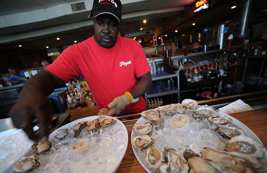 William Darby shucks oysters for lunch guests at Floyd's on Wednesday. / Beaumont