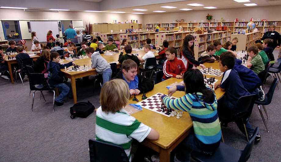 On Monday and Wednesday mornings, before school starts, the Bridge City Intermediate School Library is filled with over fifty kids wanting to play chess.  Sometimes there are not enough boards and pieces for everyone to play and there is a waiting list to join the club.  Dave Ryan/The Enterprise