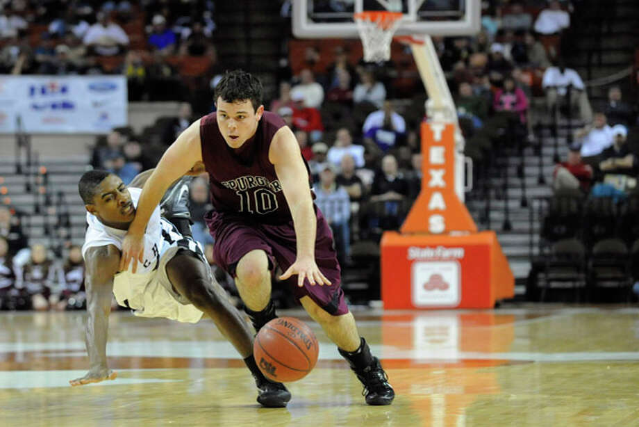 Spurger's Chase McGallion drives up court against  a Cayuga defender during their semifinal matchup at the  UIL Boys Basketball State Tournament in the Frank Erwin Center at the University of Texas, Austin, Texas. Thursday, March 11, 2010. Valentino Mauricio/The Enterprise