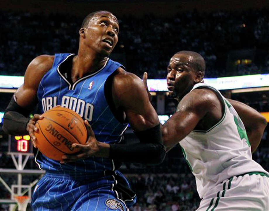 Orlando Magic center Dwight Howard, left, looks to shoot against Boston Celtics center Kendrick Perkins in the first half of Game 3 of the NBA Eastern Conference basketball finals in Boston on May 22. AP Photo/Elise Amendola / AP