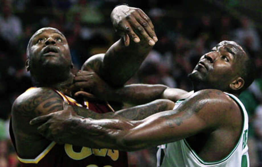 Boston Celtics center Kendrick Perkins, right, and Cleveland Cavaliers center Shaquille O'Neal, left, push off each other on a rebound during the first half of Game 4 in a second-round NBA basketball playoff series Sunday, May 9, 2010, in Boston.(AP Photo)