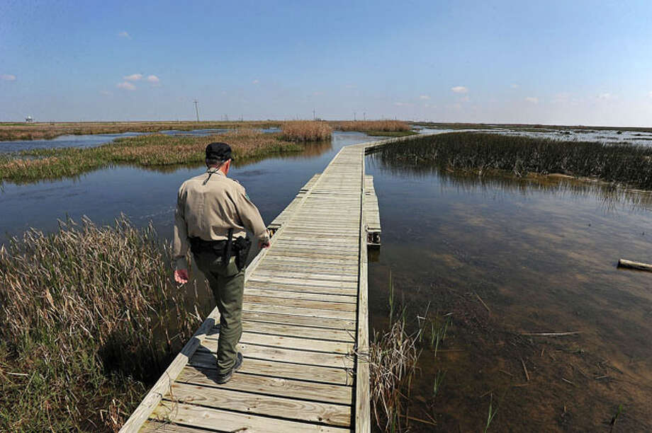 Tracy Ferguson tours the boardwalk near Sea Rim State Park. Guiseppe Barranco/The Enterprise