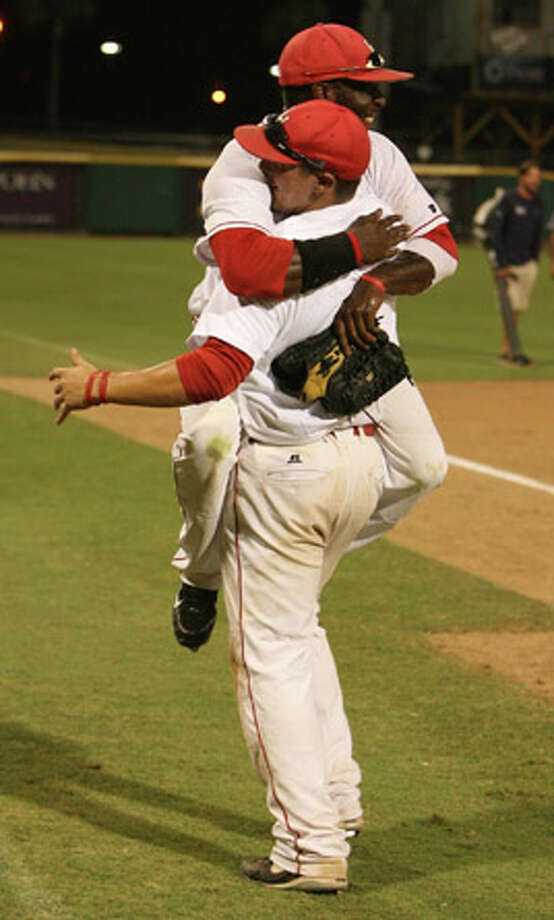 Lamar Cardinals Anthony Moore and Aaron Buchanan celebrate after the Cardinals win the 2010 Southland Conference Tournament championship game 17 to 7 over the Texas States Bobcats at Whataburger Field in Corpus Christi, Texas Saturday, May 29, 2010.