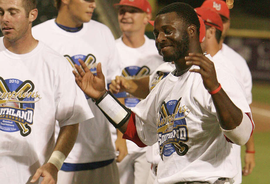 Lamar Cardinals Anthony Moore tries on his 2010 Southland Conference Tournament championship t-shirt after the Cardinals take the championship 17 to 7 over the Texas States Bobcats at Whataburger Field in Corpus Christi, Texas.