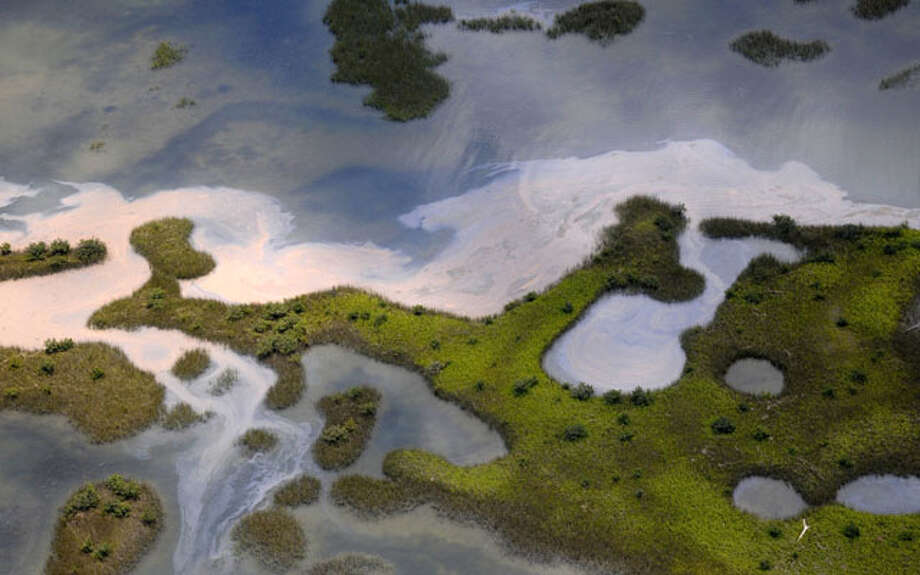 An aerial vew of the northern Chandeleur barrier islands shows sheens of oil reaching land May 6 in the Gulf of Mexico. The islands rest 20 miles from the main Louisiana coastline. AP Photo/David Quinn / FR74919 AP