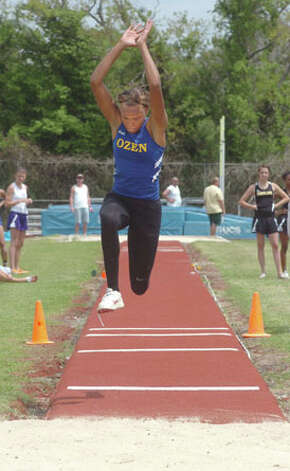 Ozen's A'Lexus Brannon completes a 40 ft. 5 & 1/2 inch triple jump at the District 20-4A track meet at West Brook in Beaumont on Monday. Pete Churton/The Enterprise / Beaumont