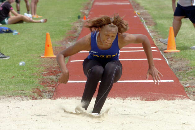 Ozen's A'Lexus Brannon lands a triple jump during the District 20-4A track meet at West Brook High Schoo. Pete Churton/The Enterprise / Beaumont