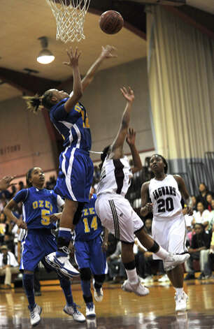 Ozen's A'Lexus Brannon denies the Cougars a lay up during a close match up at Central. Guiseppe Barranco/The Enterprise / Beaumont