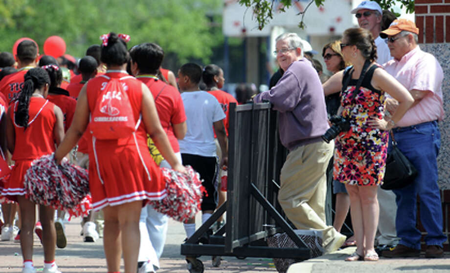 Spectators watch as the Neches River Fest Parade arrives at Crockett Street in Beaumont, Saturday. Tammy McKinley/ The Enterprise