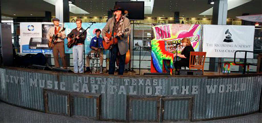 Country singer Ray Benson, center, performs Tuesday with the Marshall Ford Swing Band at the Austin-Bergstrom International Airport in Texas. / Austin American-Statesman