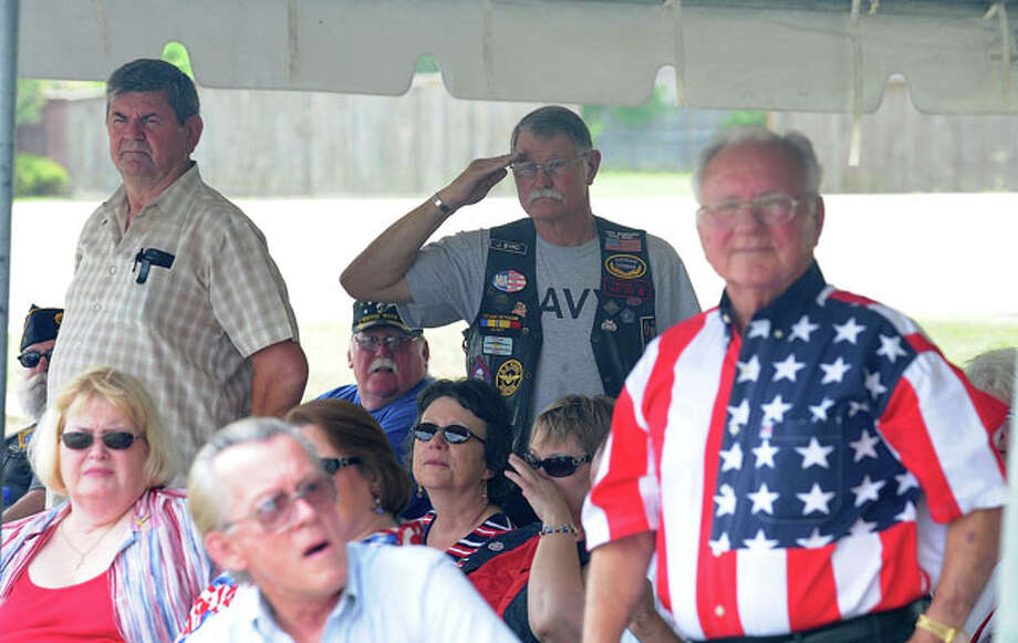 Navy veterans stands while the branch's theme song is played. Guiseppe Barranco/The Enterprise
