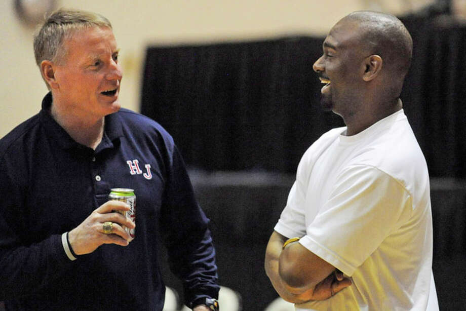 Hardin-Jefferson head coach Todd Sutherland, left, and Silsbee  head coach Travis Williams have a friendly chat beore their teams meet each other in the Class 3A, Region III  basketball tournament final at Sam Houston State University. Friday. March 5, 2010.  Valentino Mauricio/The Enterprise
