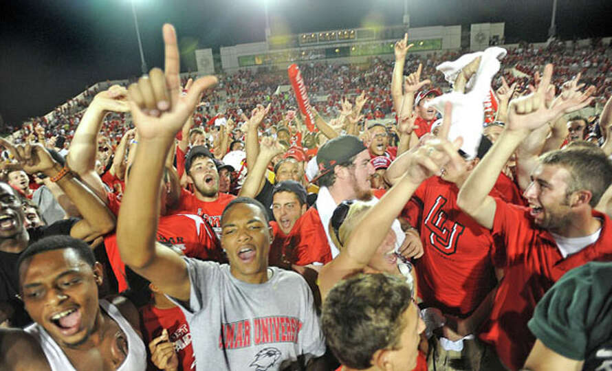 Lamar students rush the field after the Cardinals beat the Warriors 21 to 14 in the university's fir