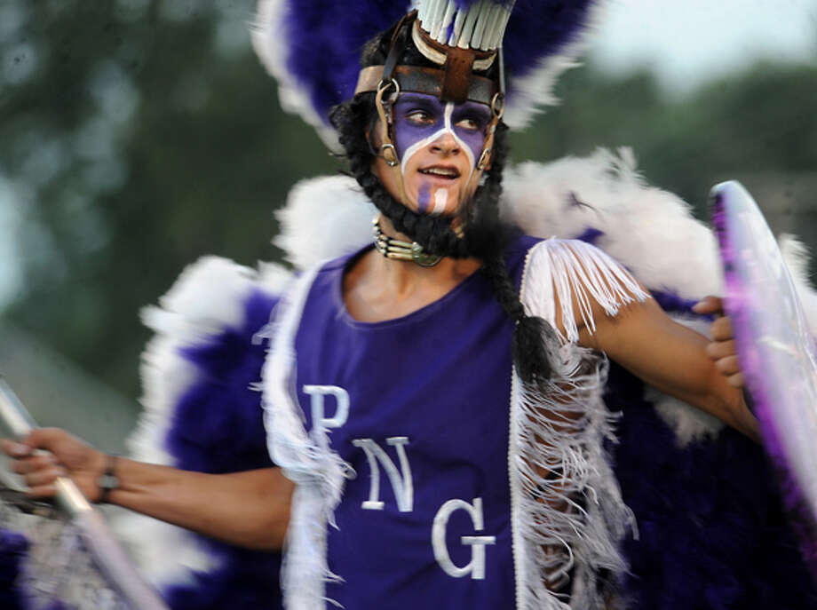 Brandon Provost performs as the Indian Spirit mascot during a pep rally at Port Neches-Groves High School. Tammy McKinley/The Enterprise / Beaumont