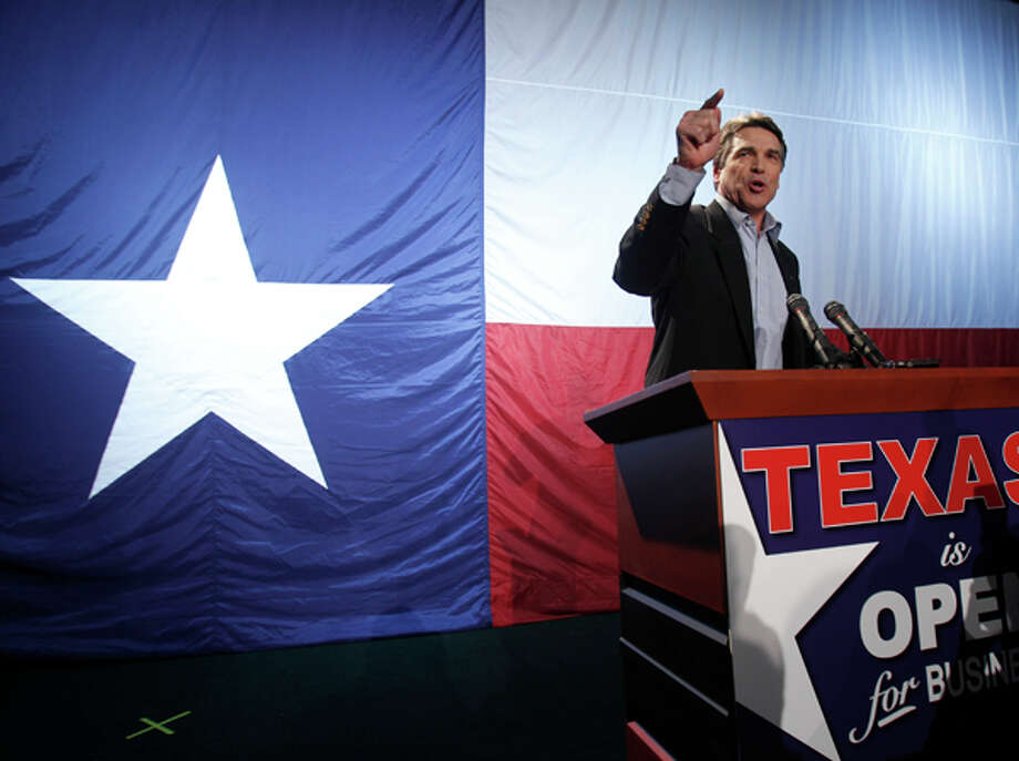 Gov. Rick Perry, right, along with fellow republicans U.S. Sen. John Cornyn, center, state agriculture commissioner Todd Staples, and state attorney general Greg Abbott, bottom, answer questions after early voting in Austin on Monday. AP Photo/Jack Plunkett / AP