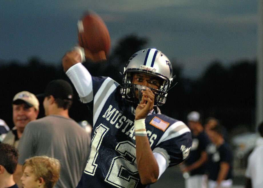 West Orange-Stark senior quarterback Reggie Garrett warms up before the start of Friday night's game against Jasper. Garrett was taken off the field on a stretcher in the second quarter of the game and shortly after was pronounced dead at the Baptist hospital. Beth Rankin/The Enterprise