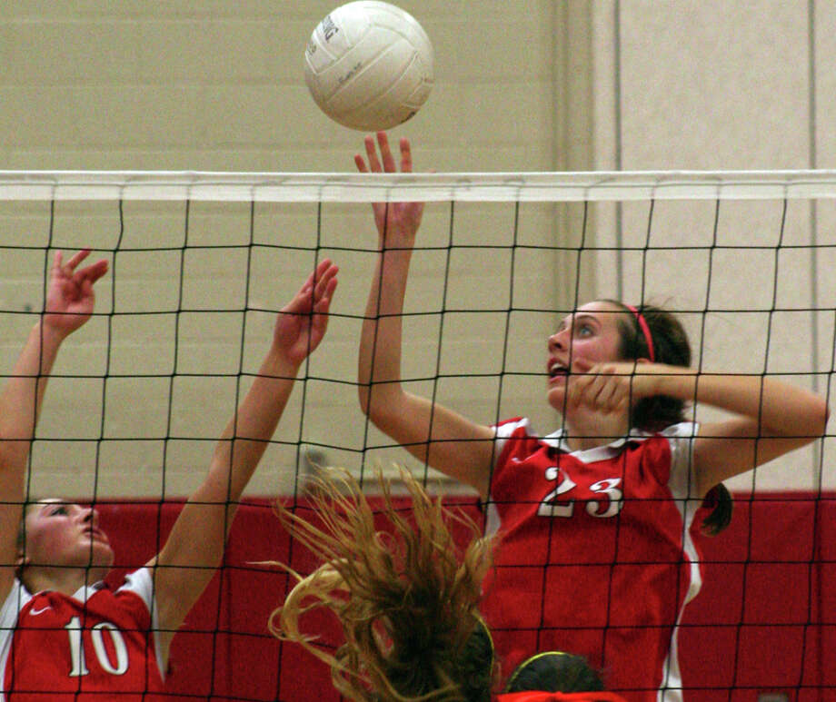 Warde's Christina Fatse and Angie Walker go up for a block in the Mustangs' 3-0 loss to Staples on Wednesday night at Fairfield Warde High School. Photo: Tim Parry / Fairfield Citizen freelance