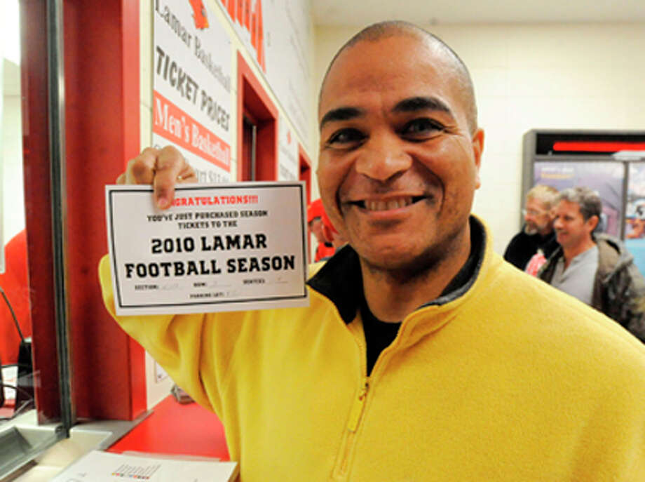 Tommy Lavergne,  of Port Arthur, holds the receipt for his 2010 Lamar Football season tickets. Valentino Mauricio/The Enterprise / Beaumont