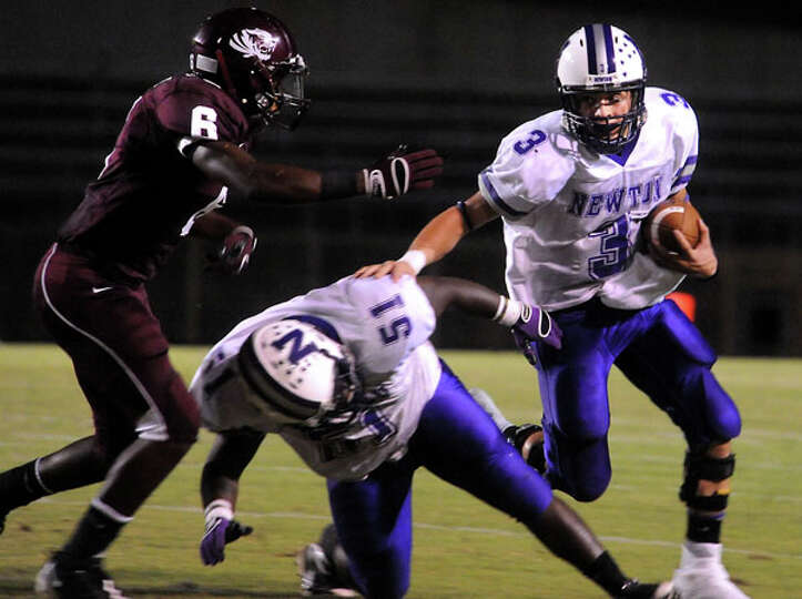 Newton's Halston Flanigan runs the ball as Tevin Adams tries to block Silsbee's Leroy Simmons at Sil