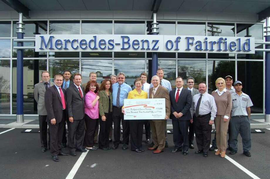 Mercedes-Benz of Fairfield donated $7,350 to the Bridgeport Rescue Mission on behalf of all clients who purchased a car from the dealership in September. Pictured from left are (back row):  Mercedes-Benz of Fairfield sales consultants Paul Brown, John Valentino, George Boccuzzi, Rodney Hill, Alexander Prisco, Area Vice President for Penske Automotive Group Randall Seymore, Mercedes-Benz of Fairfield manager Don Spillane and Victor Alvarado. (Front Row): Sales Manager Dimitry Shurba, Ray Latka, Lily Rodriguez, Vicky Regina, Dave Columb, Bridgeport Rescue Mission's Linda Casey and Executive Director Terry Wilcox, Mercedes-Benz of Fairfield General Manager Eric Ferits, Pre-Owned Manager Mike Pragano, Carol Grey and Joe Francis. Photo: Contributed Photo / Fairfield Citizen contributed