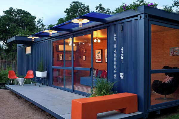 Stacey Hill?s guesthouse is made from an 8-foot by 40-foot steel shipping container, the kind used to transport products across the ocean. With the help of architect Jim Poteet, Hill repurposed the $6,000 container into an energy-efficient living space.