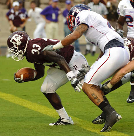 Texas A&M's Christine Michael (33) beats Stephen F Austin's Ben Wells (2) to the goal line for a 17-yard touchdown during the first quarter on Sept. 4. The Aggies won the opener 48-7, and Michael had 105 yards and two TDs and he added a 46-yard reception.