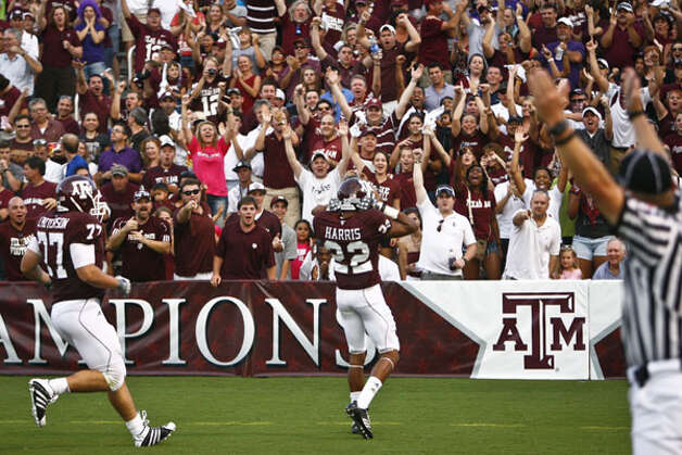 Texas A&M's Dustin Harris (22) reacts to the crowd after returning an interception for a touchdown against Stephen F. Austin on Sept. 4. Harris scored on a punt return in the Aggies' second game. / Houston Chronicle