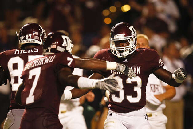 Texas A&M's Christine Michael (33) celebrates after scoring a 4-yard TD touchdown during the third quarter against Stephen F. Austin on Sept. 4. / Houston Chronicle